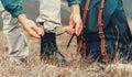 Hiker Man Tying Shoelaces On N...