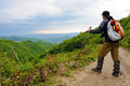 Hiker on a mounatin trek hiking man wearing backpack mountain admiring the view Royalty Free Stock Image