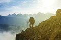 Hiker on a mount slope Royalty Free Stock Photo