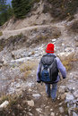 Hiker on mountain trail Royalty Free Stock Photography