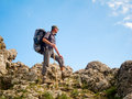 Hiker in mountains standing on a stone ridge Stock Photography