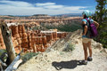Hiker overlooking bryce canyon utah chick from a high vantage point above the Royalty Free Stock Images