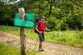 Hiker is passing by signpost Royalty Free Stock Photo