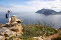 The hiker a pauses along chapman s peak section of hoerikwaggo trail in table mountain national park south africa with Stock Photography