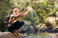 Hiker playing water young female with stream Stock Photo