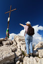 Hiker pointing the cross Royalty Free Stock Photography