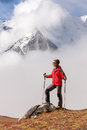 Hiker posing at camera on the trek in himalayas nepal Stock Photo