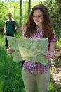 Hiker is reading a map Royalty Free Stock Photo
