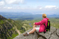 Hiker on the rock relaxing at mountain Royalty Free Stock Photography