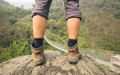Hiker shoes on hiker legs standing above bridge Royalty Free Stock Photo