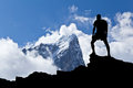 Hiker silhouette man in mountains hiking himalaya male with backpack on top of mountain looking at beautiful morning at taboche Royalty Free Stock Photos