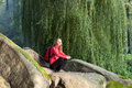 Hiker sitting on a halt in rocks among the nature Royalty Free Stock Photos