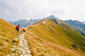 Hiker in tatra mountains kasprowy wierch poland september a man equipped for hiking standing on the walking path on september on Royalty Free Stock Photos