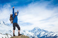 Hiker at the top of a rock with his hands raised Stock Photos
