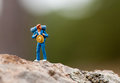 Hiker on a trail looking back figurine of rocky Royalty Free Stock Images