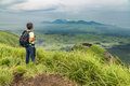 Hiker trekking to the hill top and watching mount Aso volcano Royalty Free Stock Photo