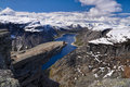 Hiker on Trolltunga, Norway Royalty Free Stock Photo