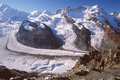 Hiker viewing Gorner Glacier, Zermatt, Switzerland Stock Photography