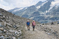 Hiker walking along a path at Grossglockner Mountain and Pasterz Royalty Free Stock Photo