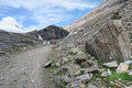 hiker walking along a path at Grossglockner Mountain and Pasterze in Austria. Summer. Royalty Free Stock Photo