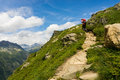 Hiker walking on a beautiful path in Aiguilles Rouges Royalty Free Stock Photo
