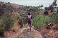 Hiker walking on path Royalty Free Stock Photo