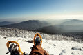 Hiker in winter mountains snowshoeing Stock Images