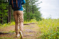 Hiker woman going on path Royalty Free Stock Photo