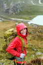 Hiker woman hiking with backpack in rain on trek living healthy active lifestyle smiling cheerful girl walking hike Stock Photos