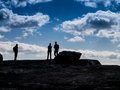 Hikers atop the cliffs in silhouette fall shawanagunks new york silhouetted against a blue aand cloudy sky Royalty Free Stock Images