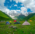 Hikers camp near ushguli georgia svaneti shkhara mountain in the background Royalty Free Stock Image
