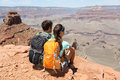 Hikers in grand canyon enjoying view of nature landscape young couple hiking relaxing during hike on south kaibab trail south rim Royalty Free Stock Images