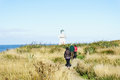 Hikers on heritage track at waipapa point the lighthouse the end of the has been automated and is still in Stock Photo