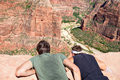 Hikers looking down zion canyon national park utah at angels landing observation point usa two male hiking adults friends together Royalty Free Stock Images