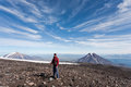 Hikers moving on volcano land in kamchatka russia Stock Image