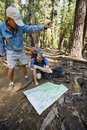 Hikers reading map. Stock Photos