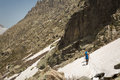 Hikers traversing snow near lac de melo in corsica two and two dogs the the mountains of restonica Stock Image