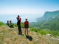 Hikers watch the terrain Royalty Free Stock Photo