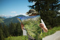 Hiking in the alps man gear studying a map looking for direction while european Royalty Free Stock Image