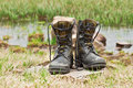 Hiking boots dirty military in the photo Stock Photo