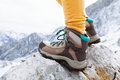 Hiking boots on mountain rocks Royalty Free Stock Photo