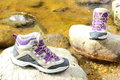 Hiking boots over a mountain stream pair of Stock Photo