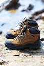 Hiking boots on rock Stock Photo