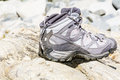 Hiking boots Standing on the stones Royalty Free Stock Photo