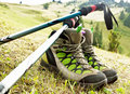 Hiking boots with trekking poles mountain and on nature outdoor background Stock Image