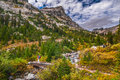 Hiking cascade canyon grant tetons female hiker on a foot bridge in Stock Image
