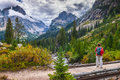 Hiking cascade canyon grant tetons female hiker on a foot bridge in Stock Images