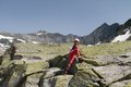 Hiking child climbing in the alps rocks mountains hohe tauern austria Royalty Free Stock Photo