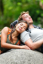 Hiking couple lovers relaxing sleeping in nature tried hikers resting lying down outdoors taking a break from hike young asian Royalty Free Stock Images
