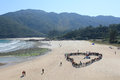 Hiking event in tai long sai wan hong kong december heart sharp is formed by hundreds of people on beach to spread out protecting Stock Photo